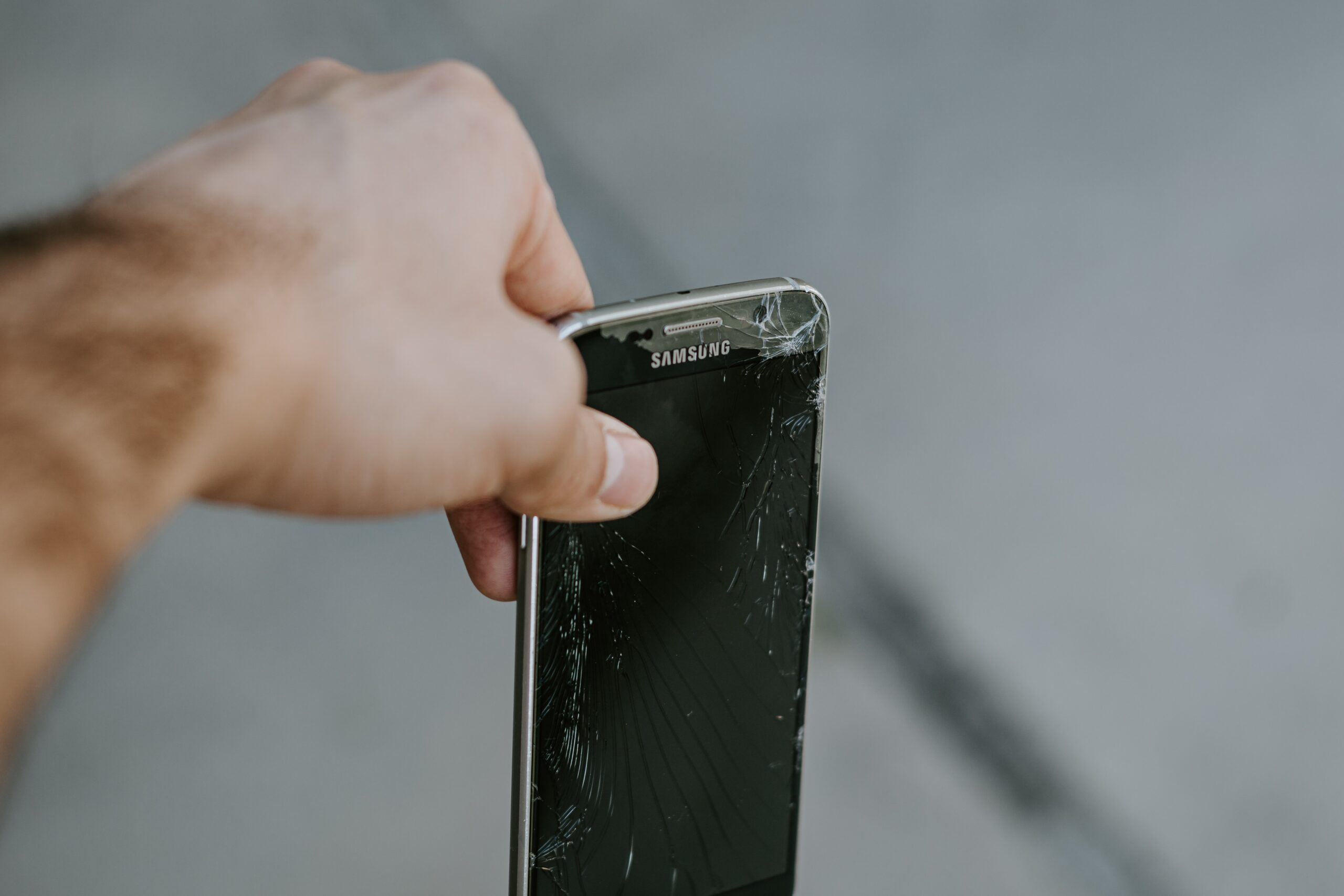 person holding black samsung android smartphone